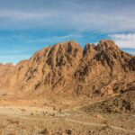 An image of Mount Sinai and a text overlay that says God is Faithful - Forget Not All His Benefits