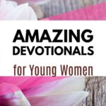 An image of pink flowers on a wooden background - Amazing Devotionals for Young Women