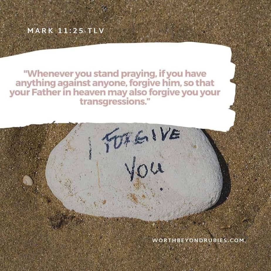 An image of a stone in the sand with I Forgive You Written on it and Mark 11:25 quoted - Stumbling Blocks
