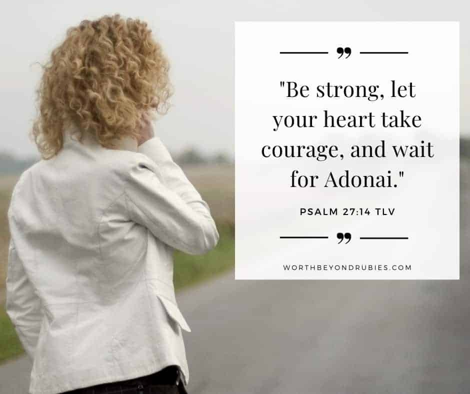 A woman waiting on a road and Psalm 27:14 quoted from Tree of Life version