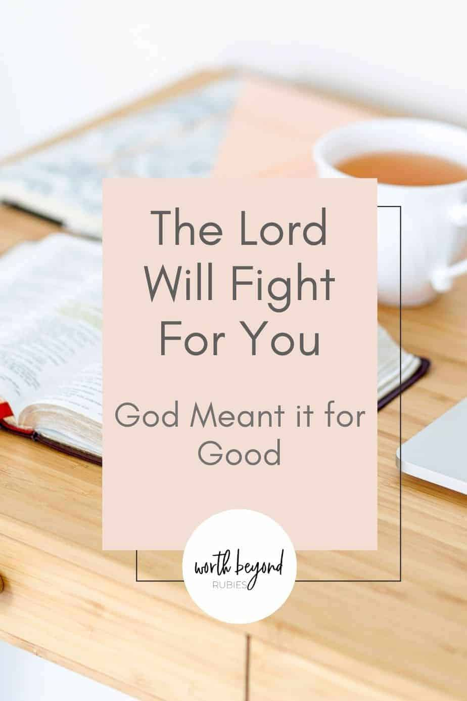 A table with an open Bible and a cup of tea with text that says The Lord Will Fight for You - God Meant it for Good