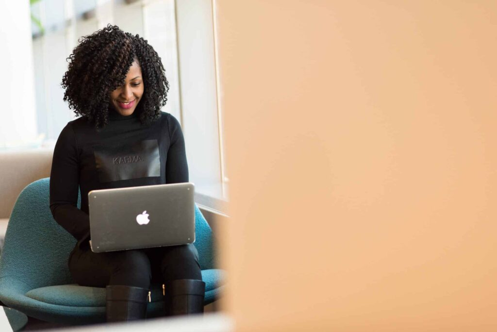 Adult African American Woman Woman Holding Macbook