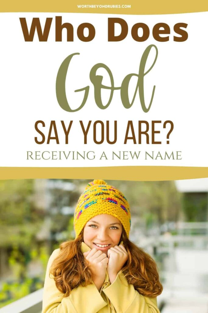 A woman with a yellow hat standing outside smiling with her hands drawn up to her chin as though she is chilly and text overlay that says Who God Says You Are - You Have a New Name