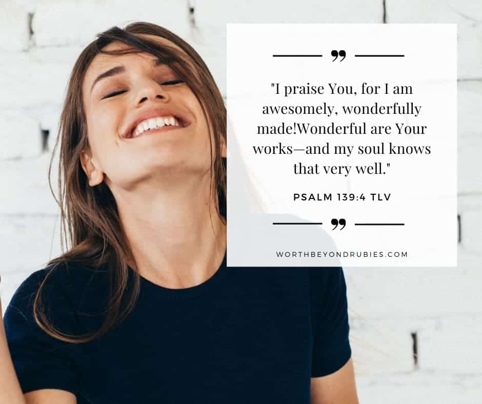 Woman dancing in front of a white brick wall with a black t-shirt on and Psalm 139:4 quoted from Tree of Life version - The Promises of God Article