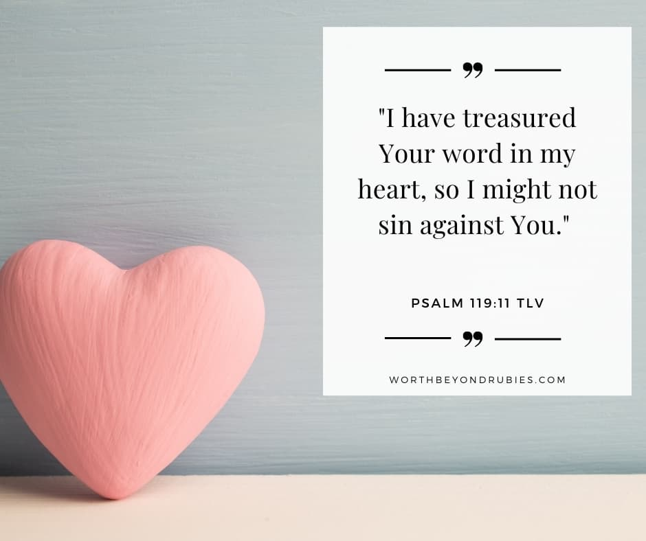 a pink heart on a table against a blue background and Psalm 119:11 quoted in Tree of Life Version