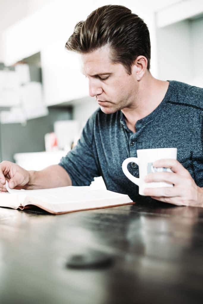 man with KJV Study Bible and a cup of coffee