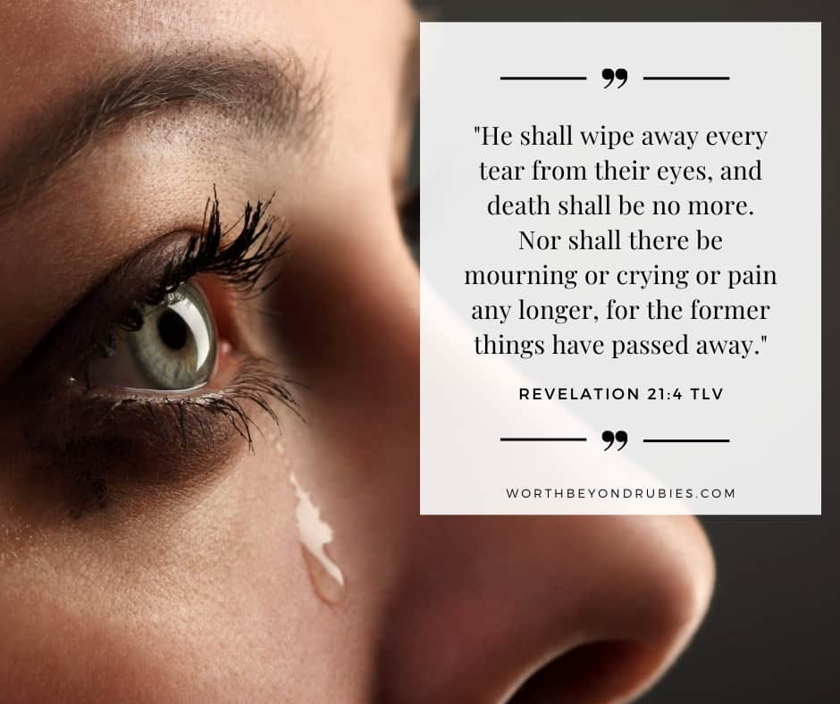 a tear in a woman's eye and Revelation 21:4 quoted in Tree of Life Version