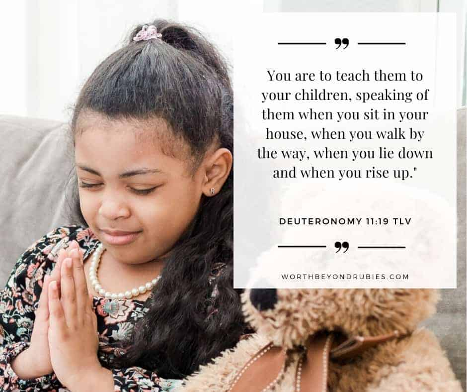A little girl praying and Deuteronomy 11:19 quoted in Tree of Life version