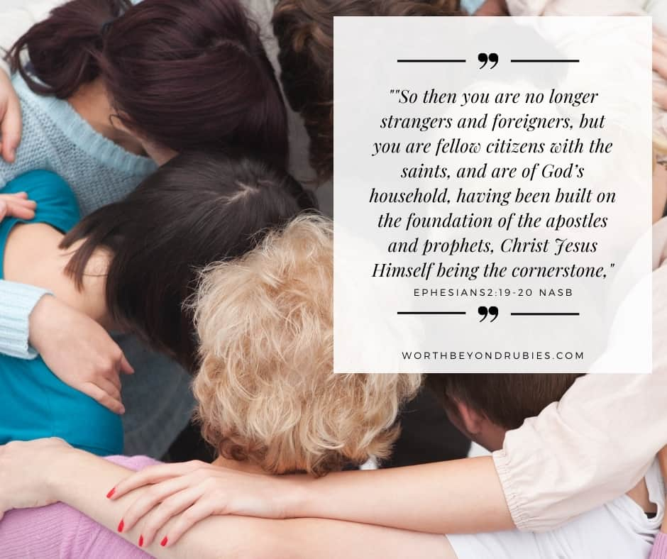 People hugging in a circle and Ephesians 2:19-20 quotes in NASB